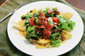 BURRITO BAR Salad Warm corn chips on bottom, fresh cut lettuce and or spinach, choice of bean, meat, and salsas... mmmmm